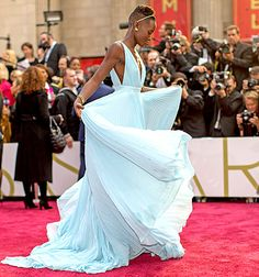 Look at Lupita's AMAZING posture. She's incredible. (Alexander Technique, We love you). Lupita Nyong'o memorably ruffled her ice blue Prada dress at the Oscars in 2014.