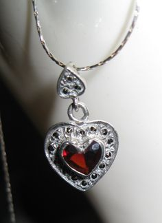 Vintage Garnet and .925 Sterling Silver Heart Pendent Necklace With Chain. $20.00, via Etsy.