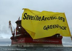 A banner in front of Gazprom's rig    Join the campaign: savethearctic.org