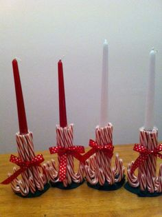 Candy cane candle holders.  Hm, maybe create a mini-menorah with these?