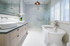 Clean-lined but with a vintage feel, the curvaceous 68-inch Emerald freestanding tub can be paired with a matching basin—or two. All are made from a stone composite. Tub, from $4,820, and sink basin, from $542; Apaiser. | thisoldhouse.com