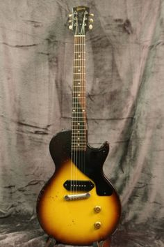 Summary: One of the true classic guitars that has stood the test of time….this instrument is so simple & yet so very wonderful. This particular Gibson was made in 1956 and it has the checking, nic. Gibson Electric Guitar, Gibson Guitars, Electric Guitars, Music Guitar, Cool Guitar, Gibson Les Paul Jr, Pickup Covers, Les Paul Guitars, Empire