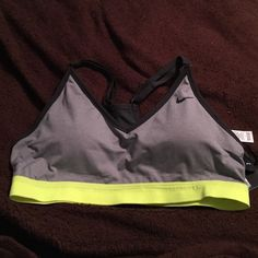 Nike sports bra Grey and black with yellow stripe at bottom. NWT! Nike Other