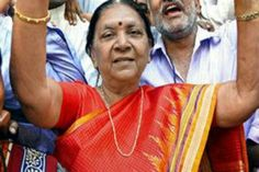 A FORMER teacher-turned-politican will be Gujarat's first woman chief minister.  Anandiben Patel, 73, is a close aide of Narendra Modi, who quit his post as chief minister today (21) to become India's new prime minister.  Patel is Gujarat's revenue minister and has previously been chairperson of the women's wing of the Gujarat unit of the Bharatiya Janata Party (BJP).