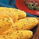 Kathy's Herbed Corn Recipe | Taste of Home Recipes: • 1/2 cup butter, softened    •    2 tablespoons minced fresh parsley    •    2 tablespoons minced fresh chives    •    1 teaspoon dried thyme    •    1/2 teaspoon salt    •    1/2 teaspoon cayenne pepper    •    8 ears sweet corn, husked