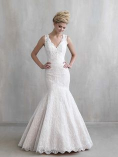 Madison James MJ204 This distinctive gown features delicate lace leading to an…