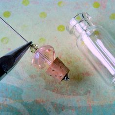How to make a decorative beaded cork and vial necklace from www.rings-things.com