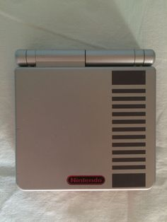 Game Boy Advance SP Classic NES Edition console up.