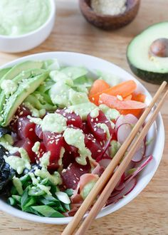 Tuna sushi bowl packed with radishes, carrots, cucumber, seaweed and avocado then drizzled in a spicy avocado wasabi dressing