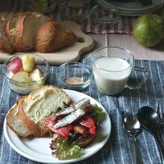 bkf = oiled sardine sandwiches, sweet potato puree soup, seafood flavored rice cracker and yogurt with fresh apple cube.