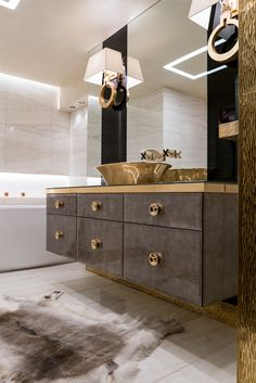Artistic Tile I Polished vein-cut Vanilla Onyx tile sets a serene tone in this Madison Avenue bath. Interior Design by Muriel Svarre of Like Mother Like Daughter Design.