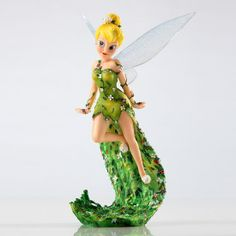 Tinker Bell Couture De' Force Figurine strikes a pose in this stunning NEW ensemble of highly detailed figurines embellished with haute couture and unique elements.