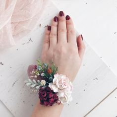 A personal favorite from my Etsy shop https://www.etsy.com/listing/571035641/burgundy-flower-wrist-corsage-fall-wrist