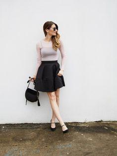 Girl in black flared skirt, blush top, mary jane heels. #holidaylook #ontheblog