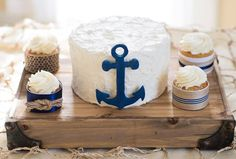 Small sweethearts wedding cake for that nautical themed wedding! Anchor is on fleek and those cupcakes will leave your guests wanting more!