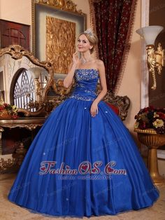 Popular Blue Quinceanera Dress Strapless Taffeta and Tulle Appliques Ball Gown http://www.fashionos.com An elegant blue quinceanera gown features a strapless neckline and a nature ruching ball gown skirt.The silver appliques decorated on the bodice add the delicate and fubulous look of the dress.The light ruching waist line together with the lace up back, hugging your bodice tightly to show out your pretty silhouette.