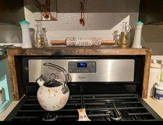 Spice rack Oven/Stove Spice Rack | Etsy Stove Oven, Kitchen Stove, Kitchen Backsplash, Diy Kitchen, Kitchen Decor, Spice Rack Over Stove, Rustic Ovens, Ohio, First Apartment Decorating