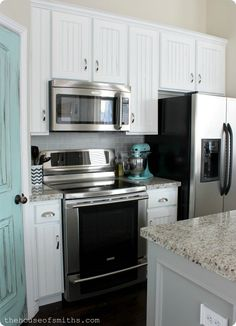 Kitchen Makeover Before and After.. I know our kitchen will look good with white cabinets now