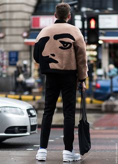 The jacket uses positive and negative space in a creative way to illustrate the face.