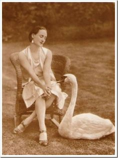 "Great ballerina Anna Pavlova with her pet swan Jack.  {""The Swan"" is one movement among many from Saint-Saëns' ""Carnival of the Animals."" Written for solo cello and piano, it draws on the ancient idea of a ""swan song"": the ancient Greeks and Romans thought that the mute swan, after a lifetime of silence, sings one beautiful song as it prepares for death.} Reminds me of the movie the Black Swan"