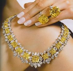 228.00 carats of Intense Yellow and White diamonds in necklace and 40.17 and 35.72 carat Intense