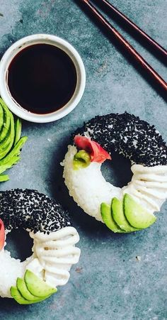 Simply grease a donut mould with coconut oil, mould in cooled sushi rice and then gently remove by lifting the pan upside down and you have a sushi donut.