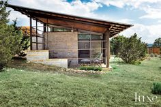 Exposed steel and limestone are right at home amid the area's rugged natural beauty. The skillion roof has overhangs that provide shading from the bright Texas sun.
