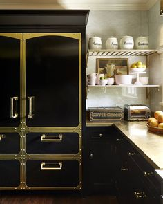 """3,070 Likes, 39 Comments - House Beautiful (@housebeautiful) on Instagram: """"A brass counter and gold hardware gleam against the deep black cabinetry and fridge. (📷:…"""""""