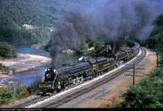 2124, 2100 Reading Steam 4-8-4's at Port Clinton, Pennsylvania by Bob Krone. Reading T-1 4-8-4s 2124 and 2100 perform a photo run along the Schuylkill River with an Iron Horse Ramble. These Rambles may have been the finest railfan excursions ever as the Reading went all out with many destinations, free souvenirs and lots of fast mainline running. Three different 4-8-4s were used over the years.