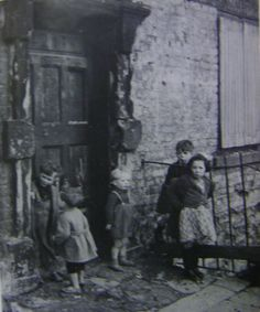Children in front of a tenement in Dublin, Ireland. (late 1800's or early 1900's)