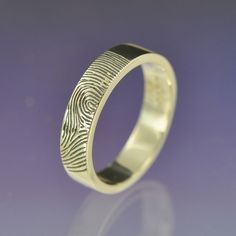 finger print wedding ring, would be great for a renewing of vows or an anniversary, wonder if you could do the whole family on one band that would be cool too :)