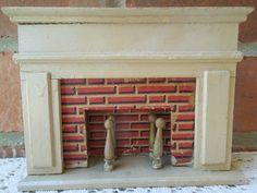 Vintage 1940's Dollhouse Fireplace Miniature Wood. $28.50, via Etsy.