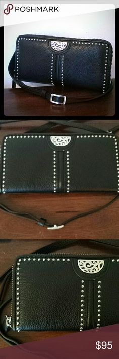 """NEW leather organizer crossbody Gorgeous Brighton organizer crossbody in a black butter soft leather and bold silver studs.  Adjustable strap can be removed. Zipper closure Three inside sections with space for cards, coin purse ,cash and more. Perfect for shopping or just everyday.  Measures Length 8"""" Hight 4"""" Adjustable strap. This is new never used. Still has plastic tags just not the price Brighton Bags Crossbody Bags"""