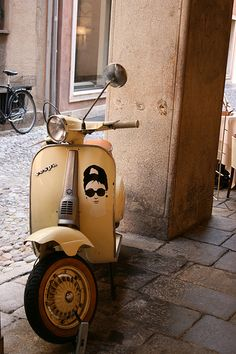 Eggshell Shade Vespa with an Audrey decal.