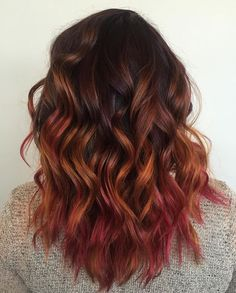 Purple roots with pink and orange bayalage