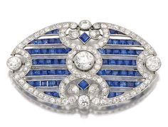 Sotheby's The Jewellery Collection of the Late Michael Wellby: Lot 177 – Sapphire and diamond brooch, circa 1910 Designed as an open work plaque millegrain set with calibré-cut sapphires, circular-cut and rose diamonds, indistinct marks, fitted case signed London & Ryder, 17, New Bond St., London, W.