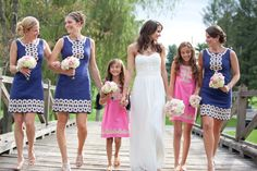 bride with bridesmaids and flower girls in Lilly Pulitzer navy and pink dresses