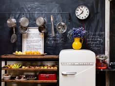 Gaby Dellal, London home renovation, baker's tray, hanging pots and pans, English Electric refrigerator, Remodelista