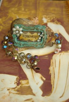 jewelry by vintage pretty... interesting use of old belt buckle.