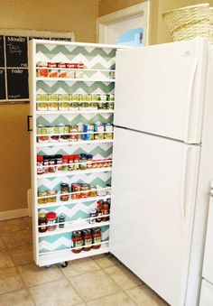 DIY Canned Food Organizer Tutorial   This can organizer beside the fridge would use up wasted space for storage!