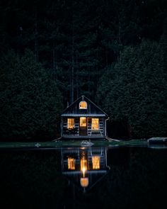 Isolated lakeside cabin bekons at night Forest Cabin, Night Forest, Forest House, Getaway Cabins, Lake Cabins, Lakeside Cabin, Haus Am See, Tiny House Cabin, Tiny Houses