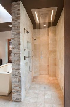 stacked stone tile Bathroom Contemporary with beige stone wall double