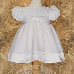 Your baby girl will look beautiful in this white organza Easter christening baptism dress gown by Little Things Mean A Lot. Sweet organza overlaid baby dress with satin hem and waist band. Made of in the USA of poly cotton and poly organza. Hand wash. Shi