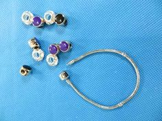 Silver plated clam clasp snake chain bracelet for European charms beads $1 - http://www.wholesalesarong.com/blog/silver-plated-clam-clasp-snake-chain-bracelet-for-european-charms-beads-1/