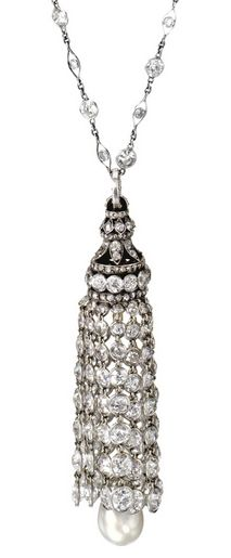 An Art Deco Platinum, Diamond and Natural Pearl Tassel Necklace, Circa 1920. The tassel composed of graduated fringes of collet-set old European-cut diamonds and a natural pearl measuring approximately 9.56 by 9.00 mm., capped by rose-cut and old European-cut diamonds, suspended from a necklace of fancy links collet-set with round and single-cut diamonds, the total diamond weight approximately 32.00 carats, length 23½ inches.
