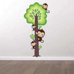Tryckt wallsticker med ett träd och söta apor