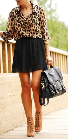 Leopard shirt with black net skirt and leather hand bag