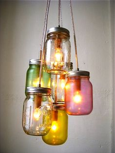 Mason jar crafts are infinite. Mason jars are usually used for decorators, wedding gifts, gardening ideas, storage and other creative crafts. Here are some Awesome DIY Mason Jar Crafts & Projects that can help you reuse old Mason Jars for decoration Mason Jar Pendant Light, Mason Jar Chandelier, Chandelier Lighting Fixtures, Mason Jar Lighting, Pendant Lighting, Diy Chandelier, Outdoor Chandelier, Pendant Lamps, Light Fixtures