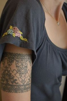 Cool tattoo for a bride (tattoo of a piece of lace from their wedding dress)... I was actually just thinking about this. Seeing if the pattern on lace from my gown would go with my paisley tattoo!?