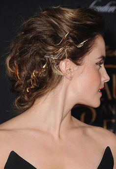 Drum roll, please. And the award for the showstopper goes to… this divine updo feat. gold leaf blingage from Emma Watson, Julius Caesar-style. Pull loosely curled hair back and pin in sections, before fastening gold hair slides to random strands: think above the ears and leading towards the nape of the neck